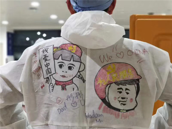 Frontline workers at airport decorate protective gear